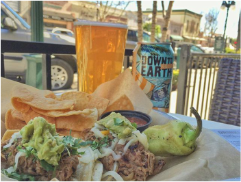 Sidewalk Table with Tacos and Beer